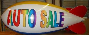 advertising blimp 14ft. - w/o artwork $665.00; with artwork from $1021.00.